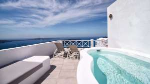 Santorini honeymoon suite jacuzzi | Blue Dolphins Apartments | Santorini Island Greece