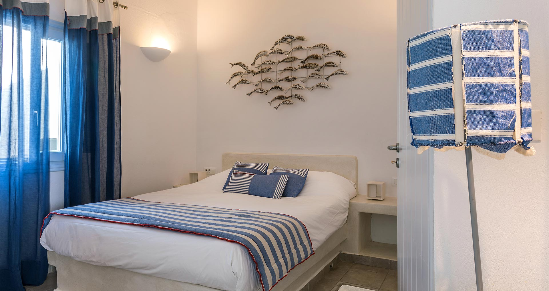 apartments in santorini with comfortable bedroom bluedolpins